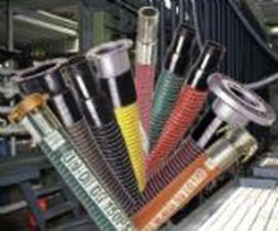 Composite chemical hoses, composite hoses